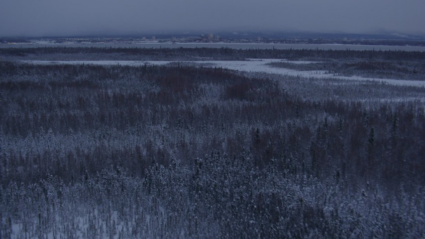 4K stock footage aerial video Downtown Anchorage seen from snowy Point MacKenzie at twilight, Alaska Aerial Stock Footage | AK0001_1679