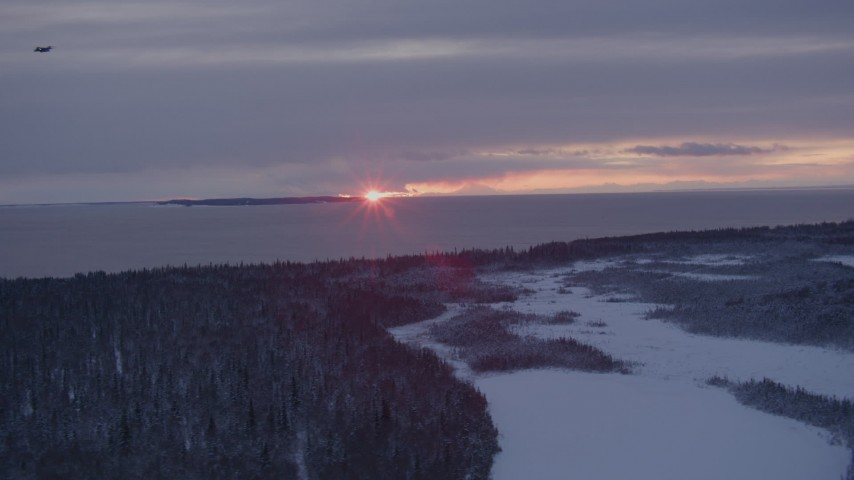 4K stock footage aerial video the twilight and clouds seen from snow covered Point MacKenzie, Alaska Aerial Stock Footage | AK0001_1682