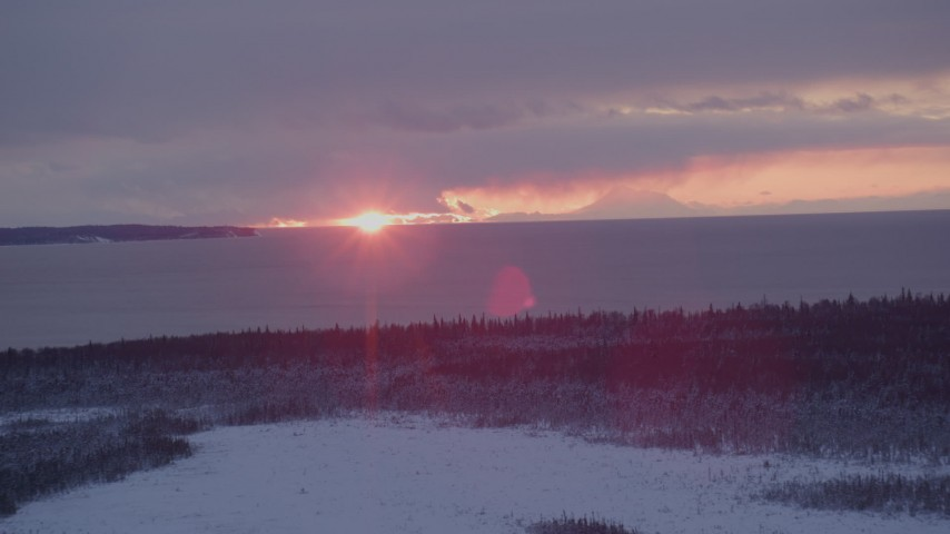 4K stock footage aerial video the twilight and clouds seen from snow covered Point MacKenzie, Alaska Aerial Stock Footage | AK0001_1683