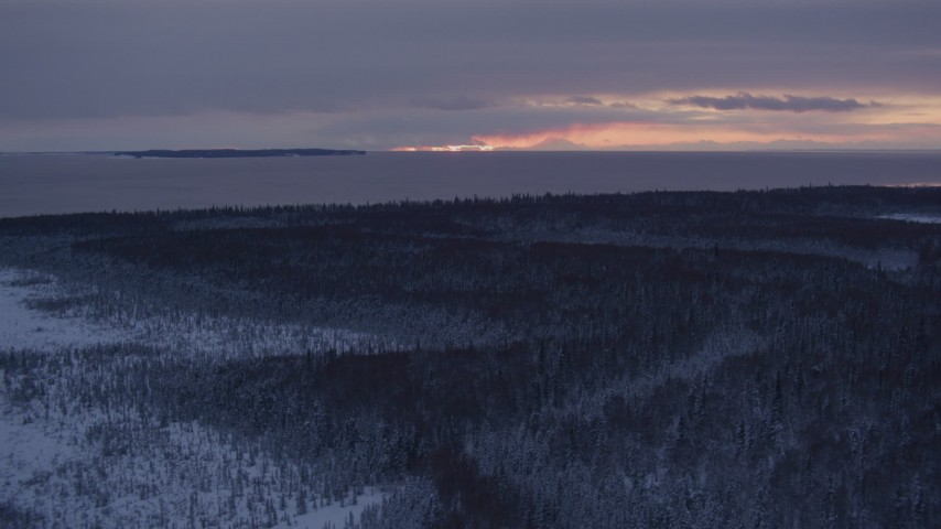 4K stock footage aerial video twilight lit clouds seen from snow covered Point MacKenzie, Alaska Aerial Stock Footage | AK0001_1684