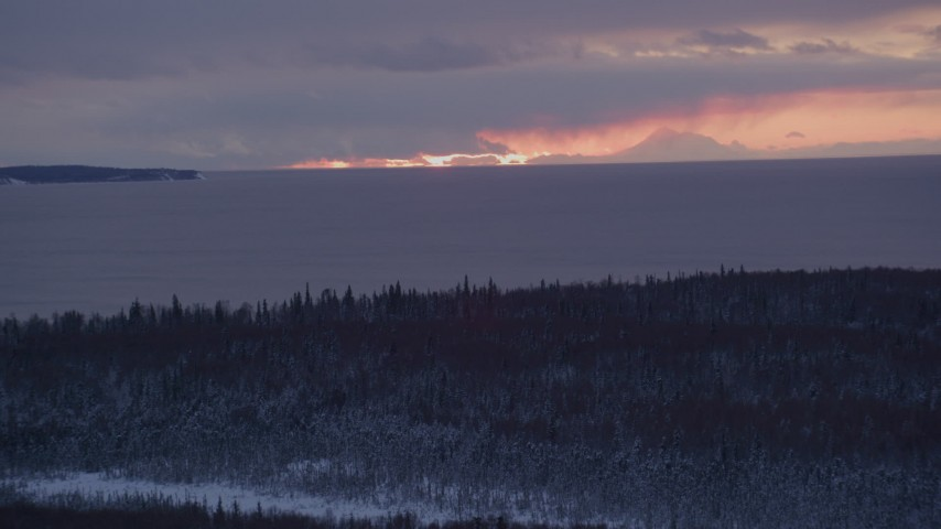 4K stock footage aerial video twilight lit clouds seen from snow covered Point MacKenzie, Alaska Aerial Stock Footage | AK0001_1685
