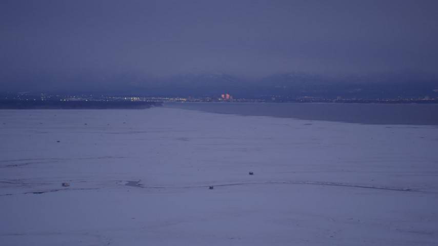 4K stock footage aerial video Downtown Anchorage seen from snowy Point MacKenzie, Alaska, twilight Aerial Stock Footage   AK0001_1713