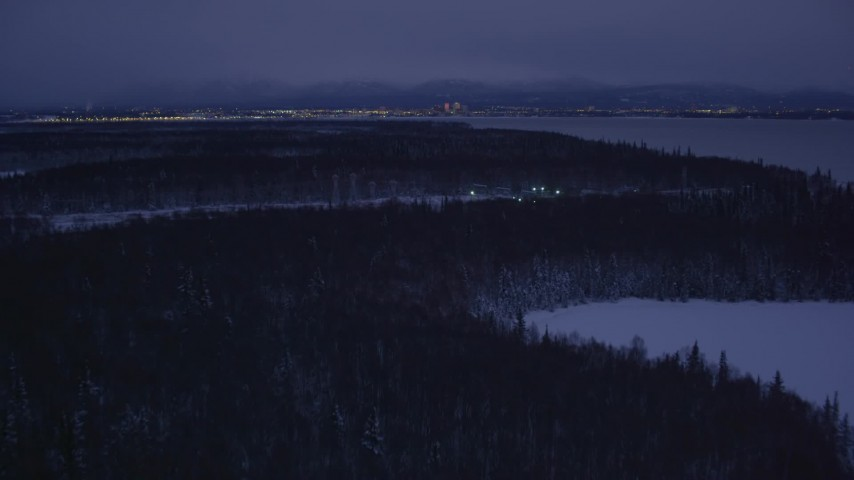 4K stock footage aerial video revealing Downtown Anchorage skyline, winter, Point MacKenzie, Alaska, night Aerial Stock Footage | AK0001_1716