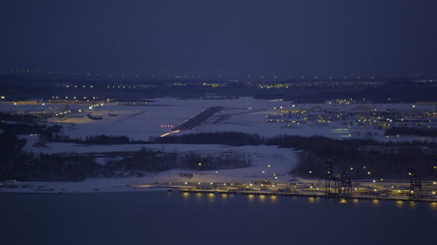 4K stock footage aerial video snow covered Elmendorf Air Force Base at night, Anchorage, Alaska Aerial Stock Footage AK0001_1719 | Axiom Images