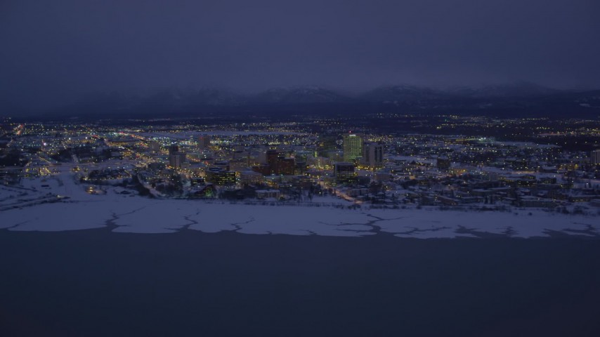 4K stock footage aerial video snow covered Downtown Anchorage at night, Alaska Aerial Stock Footage | AK0001_1720