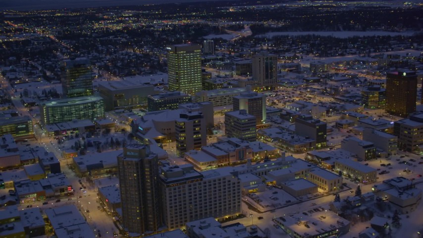 4K stock footage aerial video orbiting snow covered Downtown Anchorage at night, Alaska Aerial Stock Footage | AK0001_1722