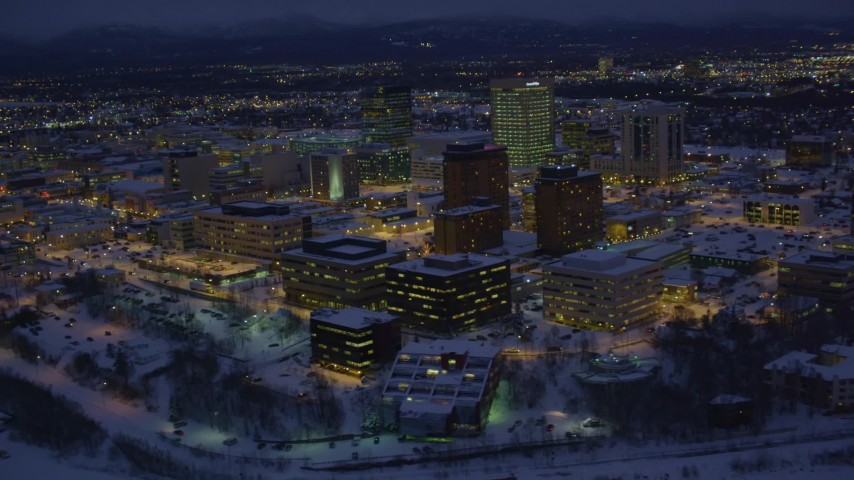 4K stock footage aerial video orbiting snow covered Downtown Anchorage at night, Alaska Aerial Stock Footage | AK0001_1723