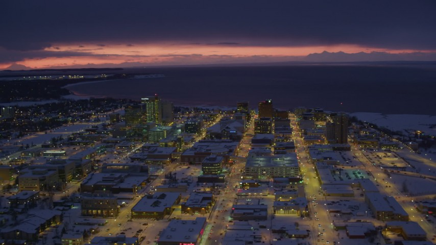 4K stock footage aerial video a view of snow covered Downtown Anchorage at night, Alaska Aerial Stock Footage | AK0001_1725