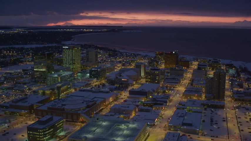 4K stock footage aerial video flying over snow covered Downtown Anchorage at night, Alaska Aerial Stock Footage | AK0001_1726