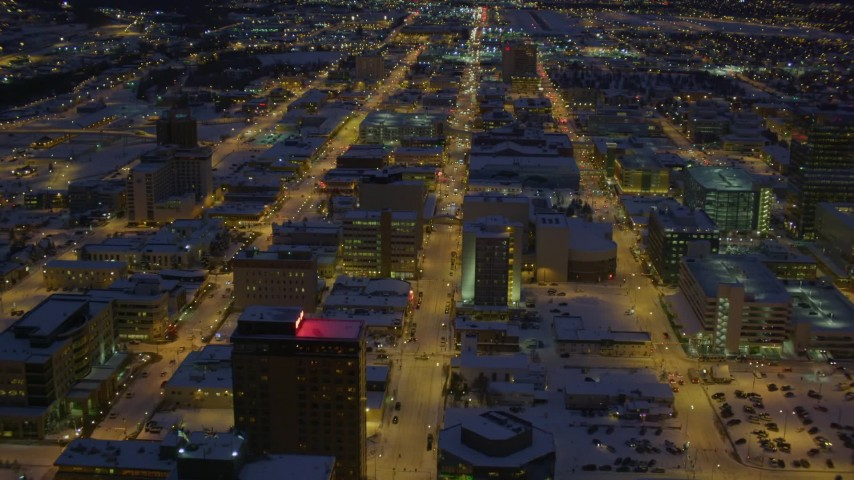 4K aerial video flying over snow covered Downtown Anchorage at night, Alaska Aerial Stock Footage | AK0001_1728