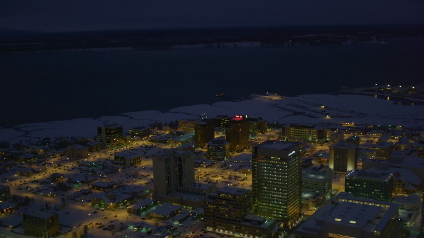 4K stock footage aerial video snow covered Downtown Anchorage, Knik Arm of the Cook Inlet at night, Alaska Aerial Stock Footage | AK0001_1730