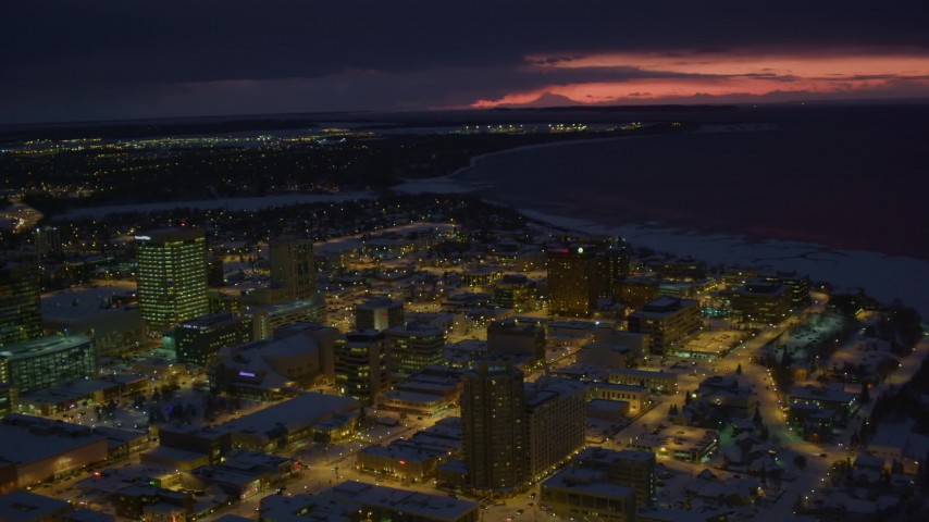 4K stock footage aerial video flyby snow covered Downtown Anchorage at night, Alaska Aerial Stock Footage | AK0001_1732