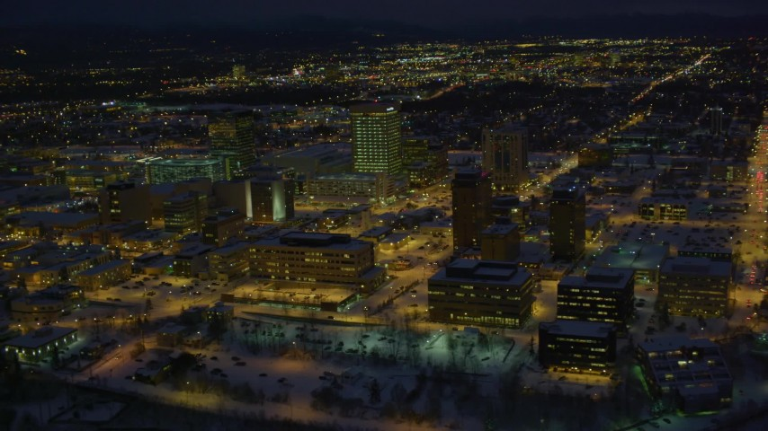 4K stock footage aerial video flying by snow covered Downtown Anchorage at night, Alaska Aerial Stock Footage | AK0001_1733