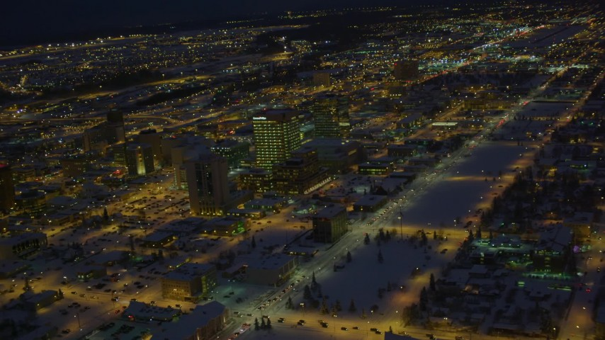 4K stock footage aerial video snow covered Downtown Anchorage and Merrill Field at night, Alaska Aerial Stock Footage | AK0001_1735