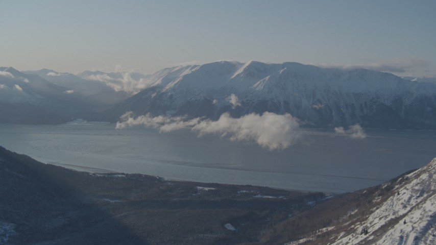 4K stock footage aerial video snowy Kenai Mountains across from Turnagain Arm of the Cook Inlet, Alaska Aerial Stock Footage | AK0001_1746