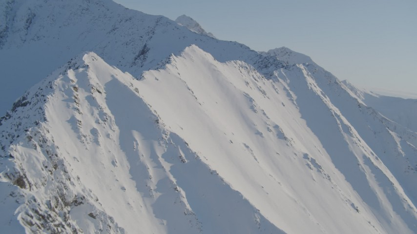 4K stock footage aerial video flying by snowy slopes in the Chugach Mountains, Alaska Aerial Stock Footage | AK0001_1749