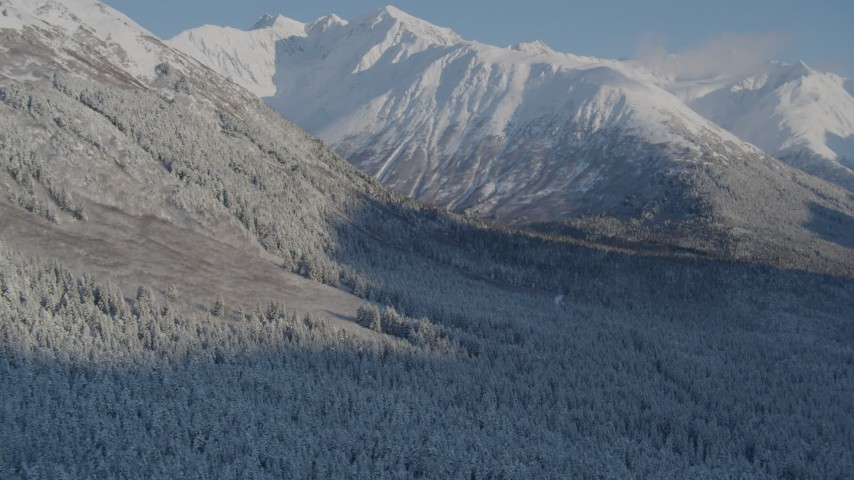 4K stock footage aerial video flying over snowy, wooded valley at base of Chugach Mountains, Alaska Aerial Stock Footage | AK0001_1759