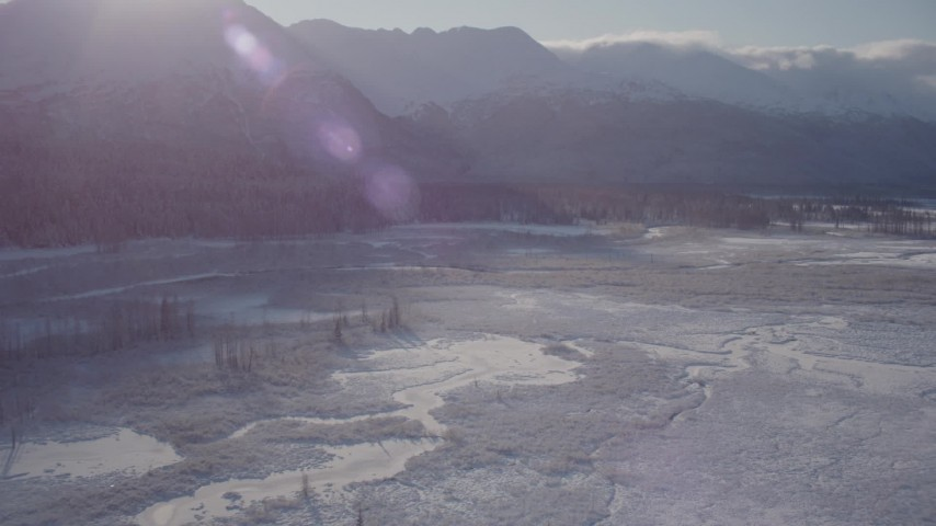 4K stock footage aerial video panning across a river valley to snow-capped Chugach Mountains, Alaska Aerial Stock Footage | AK0001_1767