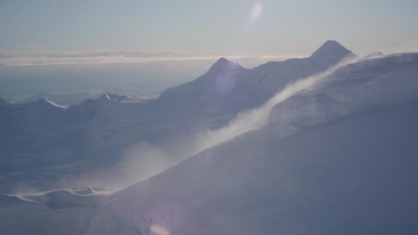 4K stock footage aerial video flyby from a windblown snowy peak, Chugach Mountains, Alaska Aerial Stock Footage | AK0001_1779