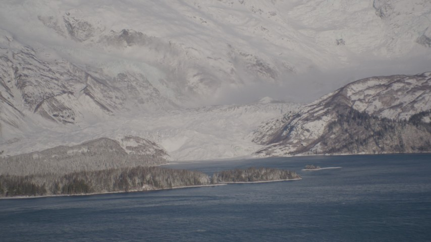 4K stock footage aerial video a small, snow covered glacier spilling into the Harriman Fjord, Alaska Aerial Stock Footage | AK0001_1788