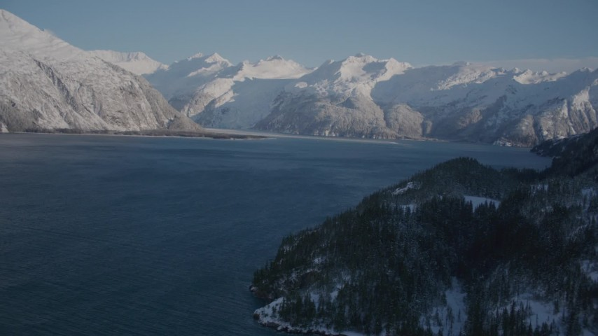 4K stock footage aerial video fly along snowy shore of Harriman Fjord toward Chugach Mountains, Alaska Aerial Stock Footage | AK0001_1789