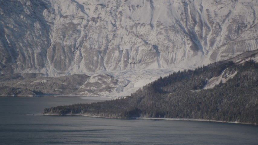 4K stock footage aerial video flying away from a snow covered glacier spilling into the Harriman Fjord, Alaska Aerial Stock Footage | AK0001_1791