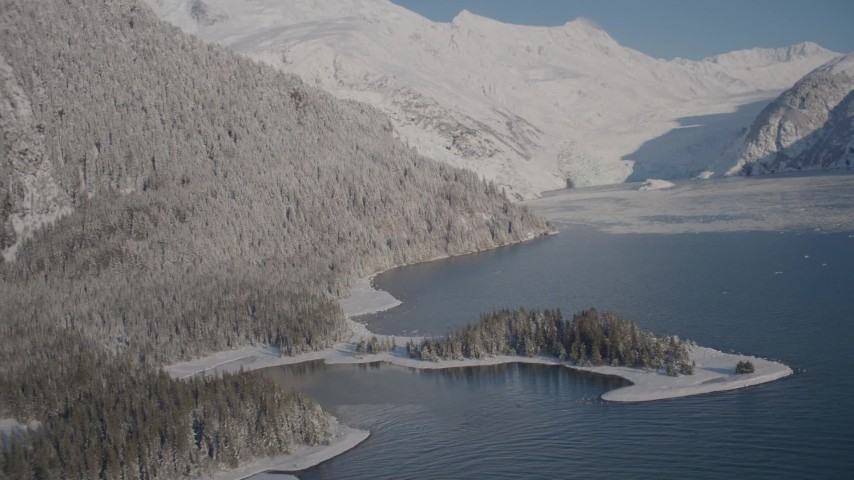 4K stock footage aerial video descending toward surface of Harriman Fjord, past snowy slopes, Alaska Aerial Stock Footage | AK0001_1792