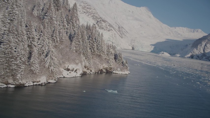 4K stock footage aerial video fly over Harriman Fjord, snowy glacier spilling down Chugach Mountains, Alaska Aerial Stock Footage | AK0001_1793