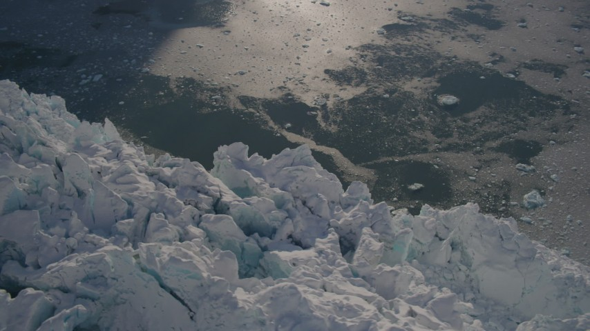 4K stock footage aerial video bird's eye view of the jagged edge of a snow covered glacier on the Harriman Fjord, Alaska Aerial Stock Footage | AK0001_1801