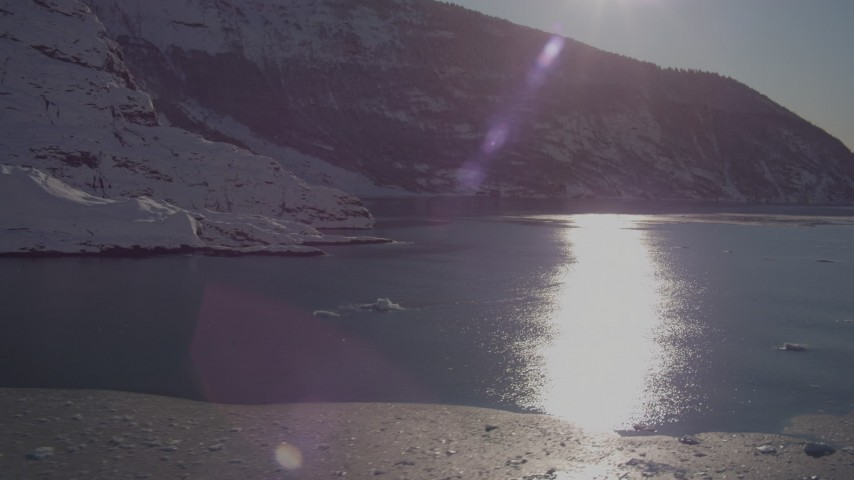 4K stock footage aerial video the sun reflecting off water in Harriman Fjord near snow covered glacier, Alaska Aerial Stock Footage | AK0001_1820