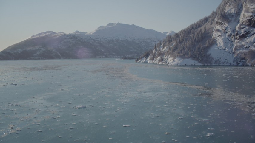 4K stock footage aerial video fly low over surface of Harriman Fjord surrounded by snowy mountains, Alaska Aerial Stock Footage | AK0001_1828