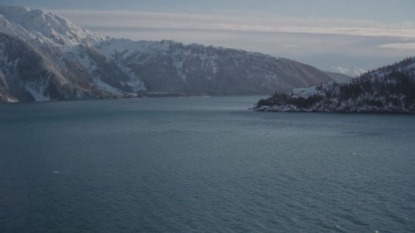 4K stock footage aerial video approach mouth of Harriman Fjord at base of snowy mountains, Alaska Aerial Stock Footage | AK0001_1832