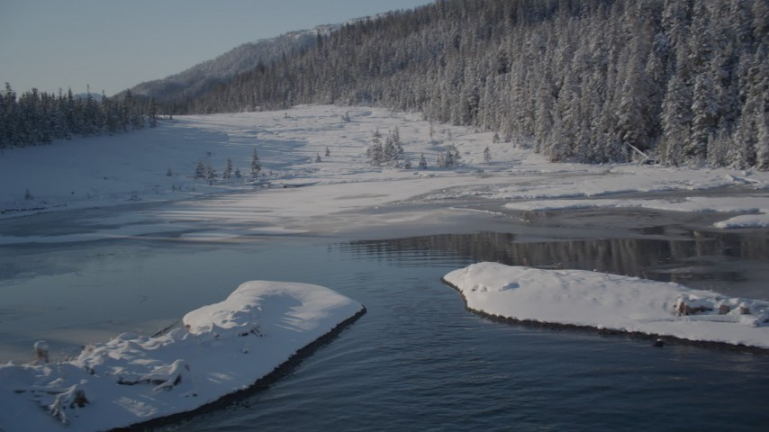 4K stock footage aerial video fly over icy shore beside snowy forest in Port Wells, Alaska Aerial Stock Footage | AK0001_1855