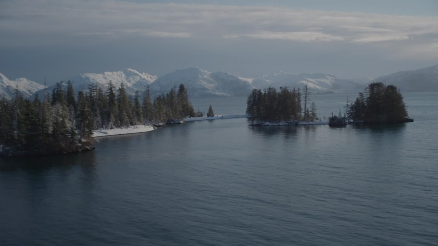 4K stock footage aerial video orbiting snow covered wooded islands in Port Wells, Alaska Aerial Stock Footage | AK0001_1859