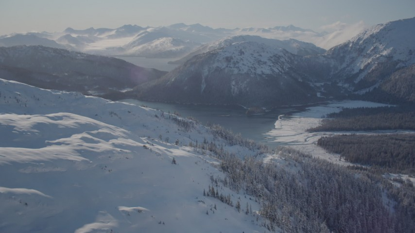 4K stock footage aerial video flying over snow covered slopes near Pigot Bay, Alaska Aerial Stock Footage AK0001_1894 | Axiom Images