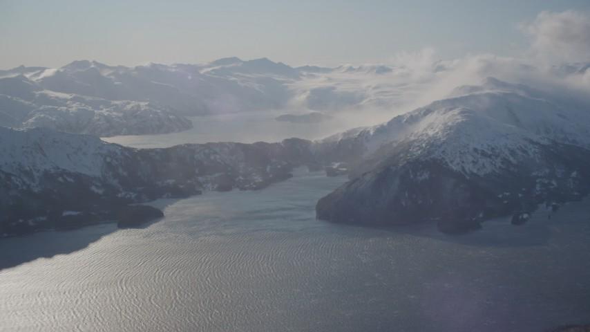 4K stock footage aerial video pan across Passage Canal, Shotgun Cove, snowy Chugach Mountains, Alaska Aerial Stock Footage AK0001_1908 | Axiom Images