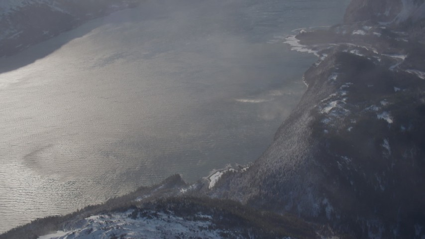 4K stock footage aerial video the windblown Passage Canal near a snowy, hilly valley, Alaska Aerial Stock Footage | AK0001_1912