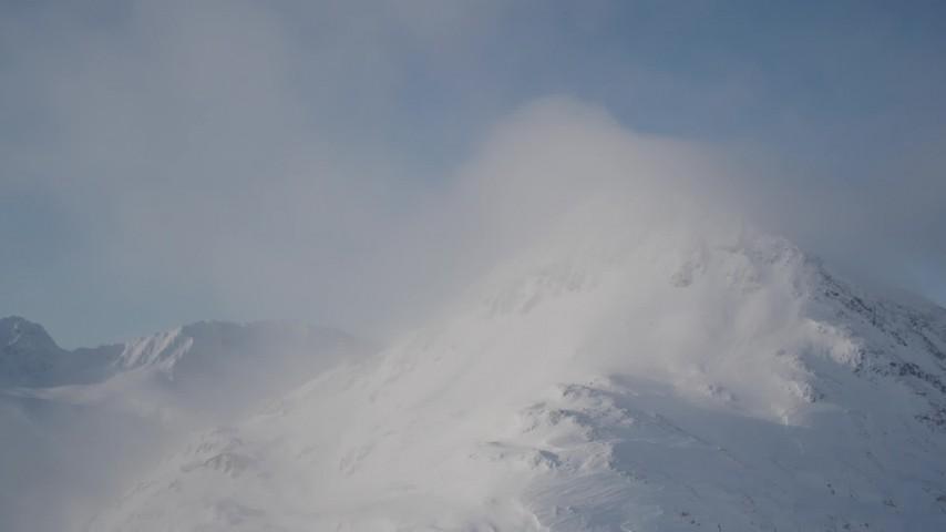 4K stock footage aerial video a cloud, snow covered mountain summit, Chugach Mountains, Alaska Aerial Stock Footage | AK0001_1914