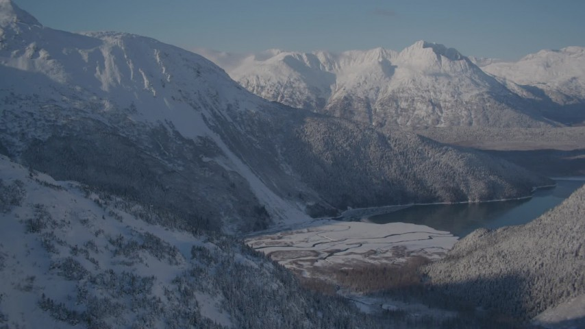 4K stock footage aerial video approaching a river valley next to Carmen Lake, Alaska in snow Aerial Stock Footage AK0001_1920 | Axiom Images