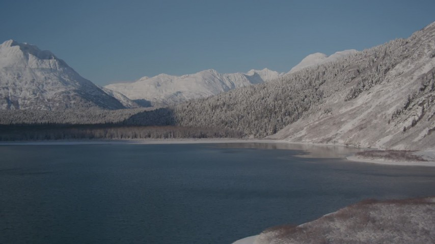4K stock footage aerial video flying over Carmen Lake, snowy Chugach Mountains in the distance, Alaska Aerial Stock Footage | AK0001_1923