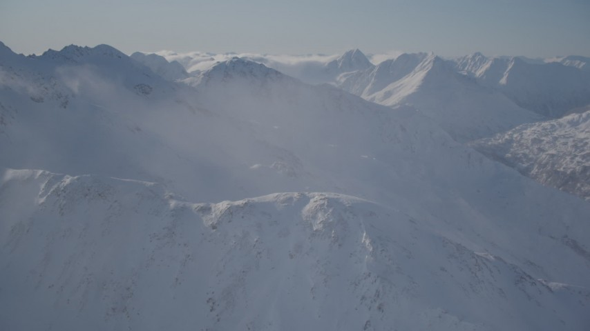 4K stock footage aerial video snow covered mountain ranges and low clouds in Chugach Mountains, Alaska Aerial Stock Footage | AK0001_1930