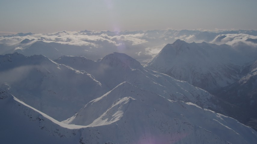 4K stock footage aerial video snowy mountain ranges and low clouds in Chugach Mountains, Alaska Aerial Stock Footage | AK0001_1932