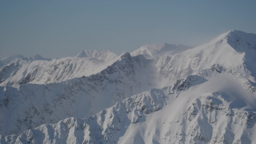 4K stock footage aerial video snow covered, windblown mountains in Chugach Mountains, Alaska Aerial Stock Footage | AK0001_1934