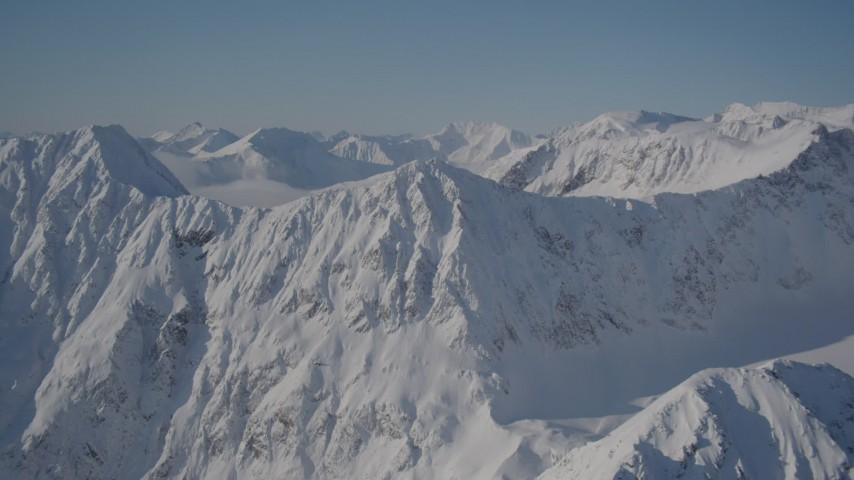 4K stock footage aerial video flying toward a snowy mountain range in Chugach Mountains, Alaska Aerial Stock Footage | AK0001_1935