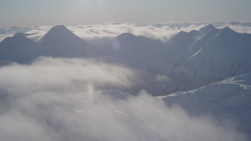 4K stock footage aerial video flying by snow covered mountains in Chugach Mountains, Alaska Aerial Stock Footage | AK0001_1938