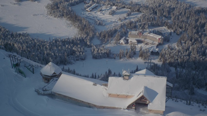 4K stock footage aerial video ski lodge on snow covered mountain, revealing Alyeska Resort, Girdwood, Alaska Aerial Stock Footage | AK0001_1968