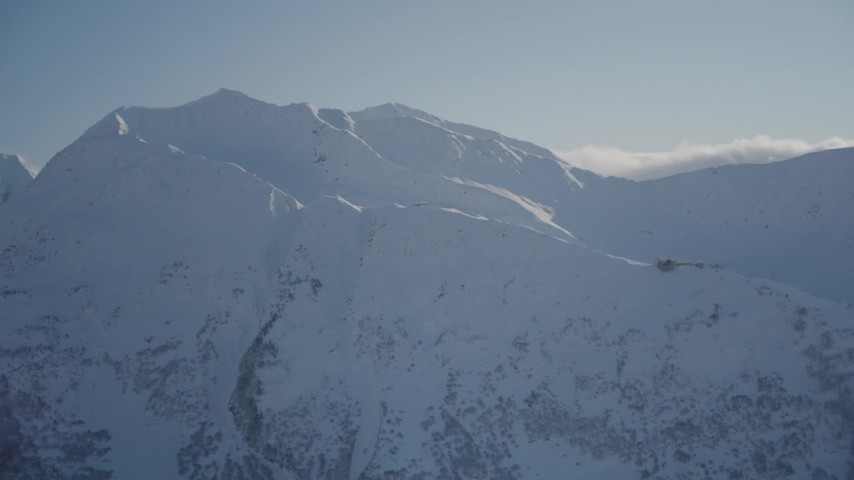 4K stock footage aerial video flying away from a snow covered mountain peak, Girdwood, Alaska Aerial Stock Footage | AK0001_1970