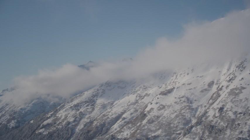 4K stock footage aerial video windblown, snow covered Chugach Mountains, Alaska Aerial Stock Footage   AK0001_1971