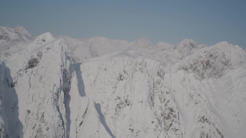 4K stock footage aerial video flying toward jagged, snowy ridge in Chugach Mountains, Alaska Aerial Stock Footage | AK0001_1974