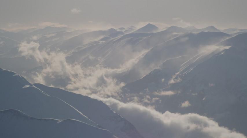 4K stock footage aerial video snow covered, windswept Kenai Mountains, Alaska Aerial Stock Footage | AK0001_1981